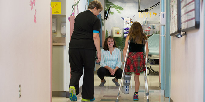 young patient on crutches